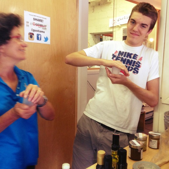 Beatrice and Charlie tasting EVOO.
